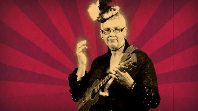 Joan playing ukulele in Steam Punk video